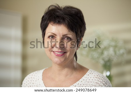 Mature woman smiling - stock photo