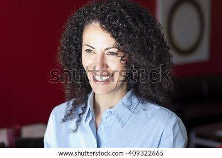 Mature Woman Smiling And Looking Away - stock photo