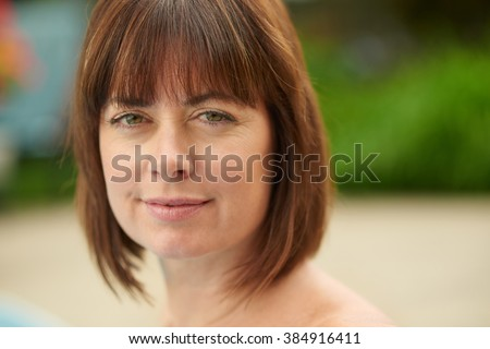 Mature woman smiling in nature