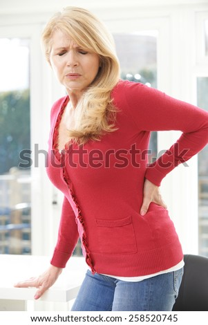 Mature Woman Suffering From Backache At Home - stock photo