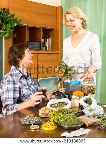 Mature woman talking with her friend about the medicinal herbs