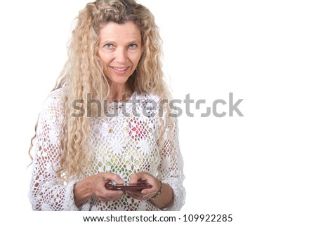 mature woman teexting on smart cell phone - stock photo