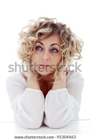 Mature woman thinking - closeup portrait - stock photo