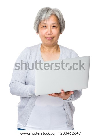 Mature woman use of notebook computer - stock photo