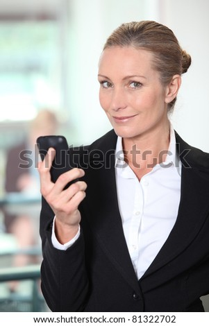 Mature woman using smartphone - stock photo