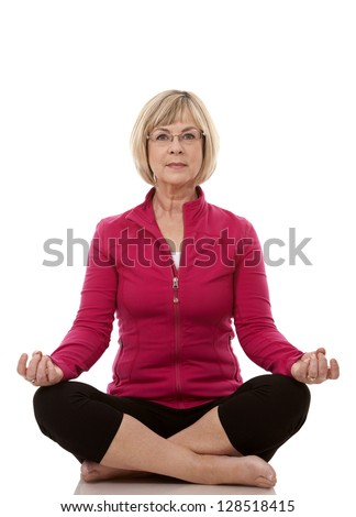 mature woman wearing fitness outfit on white isolated background - stock photo