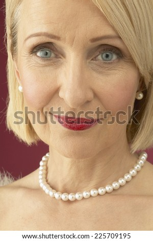 Mature Woman Wearing Pearls - stock photo