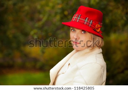Mature woman wearing retro felt hat and wool coat . Outdoor - stock photo