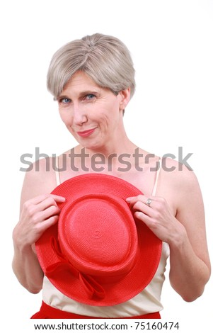 Mature woman with a red hat - stock photo