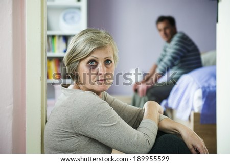 Mature woman with black eye is victim of domestic violence and abuse. - stock photo
