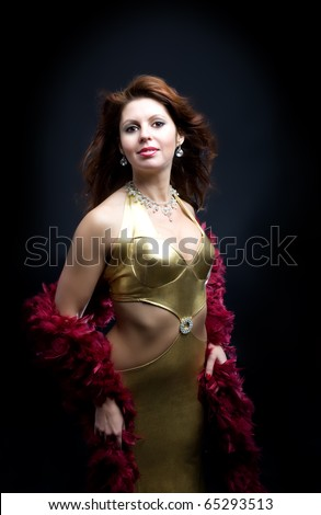 Mature woman with boa in gold dress