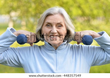Mature woman with dumbbells