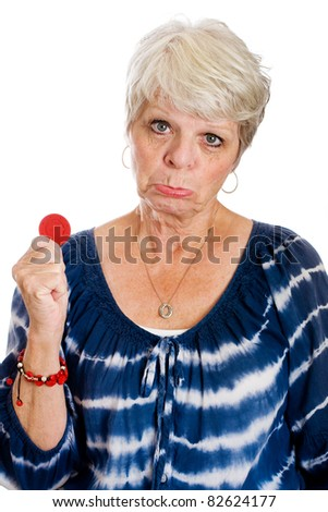 Mature woman with her last casino chip. - stock photo