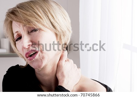 Mature Woman with neck pain - stock photo