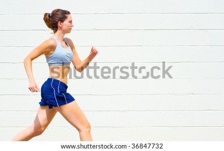 Mature woman working out in an urban setting, from a complete set of photos. - stock photo