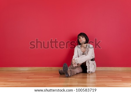 mature women sited in the floor of his new house - stock photo