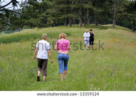 Mature womens walking together in forest mystic way - stock photo