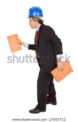 mature worker holding two bricks, isolated on white