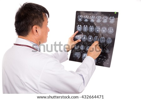 Matured and confident Asian neurology medical doctor examining head MRI images on white background