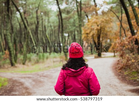Matured woman hiking in the forest at winter