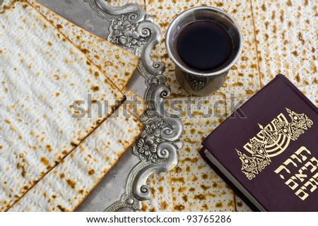 Matza bread for passover celebration and torah book - stock photo