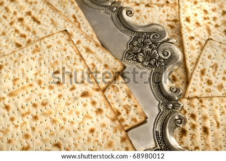 Matza bread for passover celebration on silver dish - stock photo