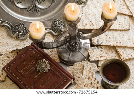 Matza bread for passover celebration with  torah and red wine - stock photo