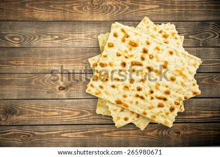 Matza. Matzo (or matzah) is bread traditionally eaten by Jews during the week-long Passover holiday - stock photo