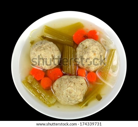 Matzo ball soup on a black background. - stock photo
