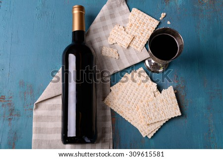 Matzo for Passover with metal tray and wine on table close up - stock photo