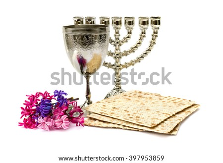 Matzo, wine, menorah and hyacinths for passover celebration on white background - stock photo