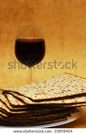 Matzot and red wine -symbols of Passover - stock photo