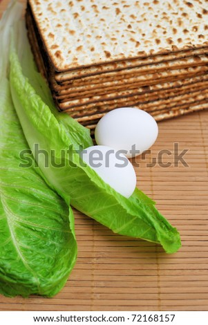 Matzot, eggs and lettuce - symbols of jewish passover - stock photo