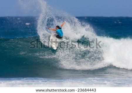 MAUI, HAWAII - DECEMBER 18, 2008:  Professional Surfer Melanie Bartels does a power turn during the Billabong Pro Maui - December 18, 2008 Maui, HI. - stock photo
