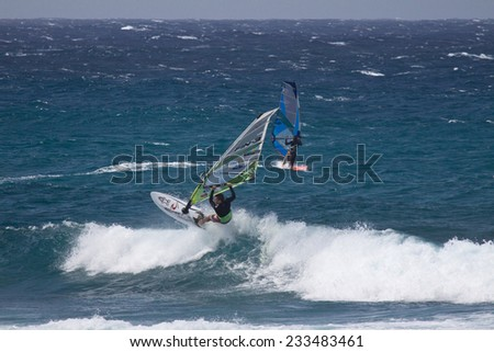MAUI, HAWAII, USA - APRIL 2009: Popping a Wheelie. Windsurfing on Maui's famous Ho'okipa Beach, located on the windy North Shore.