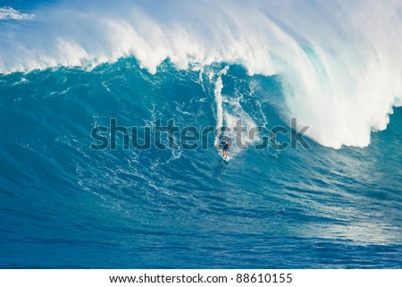 """MAUI, HI - MARCH 13: Professional surfer Billy Kemper rides a giant wave at the legendary big wave surf break known as """"Jaws"""" during one the largest swells of the winter March 13, 2011 in Maui, HI. - stock photo"""