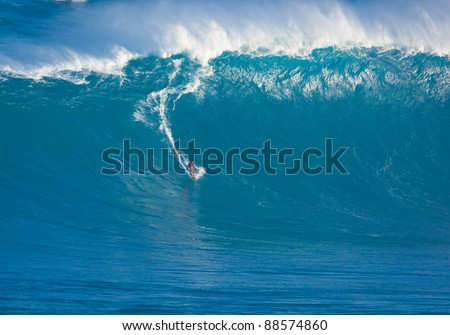 """MAUI, HI - MARCH 13: Professional surfer Francisco Porcella rides a giant wave at the legendary big wave surf break """"Jaws"""" during one the largest swells of the winter March 13, 2011 in Maui, HI. - stock photo"""