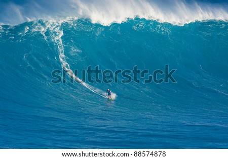 """MAUI, HI - MARCH 13: Professional surfer Marcio Freire catches a giant wave at the legendary big wave surf break known as """"Jaws"""" during one the largest swells of the winter March 13, 2011 in Maui, HI. - stock photo"""