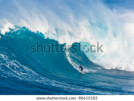 """MAUI, HI - MARCH 13: Professional surfer Marcio Freire rides a giant wave at the legendary big wave surf break known as """"Jaws"""" during one the largest swells of the winter March 13, 2011 in Maui, HI. - stock photo"""