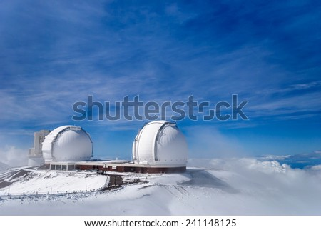 Mauna Kea and telescopes after a snowfall on the Big Island of Hawaii. - stock photo