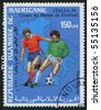 MAURITANIA - CIRCA 1990: stamp printed by Mauritan, shows soccer players and ball, circa 1990. - stock photo