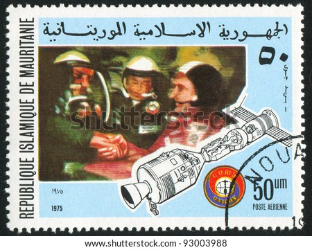 MAURITANIA - CIRCA 1975: stamp printed by Mauritania, shows Handshake in linked-up cabin, circa 1975