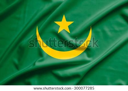 Mauritania flag on soft and smooth silk texture - stock photo