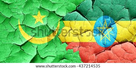 Mauritania flag with Ethiopia flag on a grunge cracked wall - stock photo