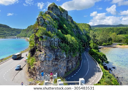 MAURITIUS - APR 28, 2013:  Road around the high cliff on the coast of Indian ocean. Mauritius island is one from preferable destination for luxury holiday in all season 