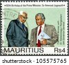 MAURITIUS - CIRCA 1990: A stamp printed in Mauritius shows The Prime Minister Jugnauth with Sir Seewoosagur Ramgoolam late governor general, 60th Birthday of the Prime Minister, circa 1990 - stock photo