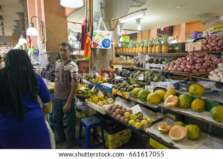 MAURITIUS, MAY 22, 2017. People selling groceries in the main market Grand Mark of Port Louis, in Mauritius on May 22nd 2017.