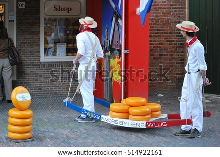 MAY 31, 2014, AMSTERDAM, NETHERLANDS: CIRCA. Workers moving cheese to a cheese market in Amsterdam.