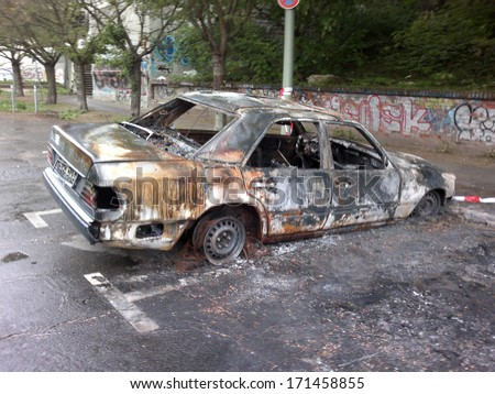 MAY 1, 2011 - BERLIN: burned and vandalized cars which has become a common sight on the streets of Berlin, Berlin-Prenzlauer Berg. - stock photo