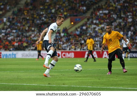 May 27, 2015: England Premier League side Tottenham Hotspur's striker Harry Kane (18) dribbles the ball in the friendly match against the Malaysian Team. Tottenham Hotspur is on a Asia-Australia tour. - stock photo